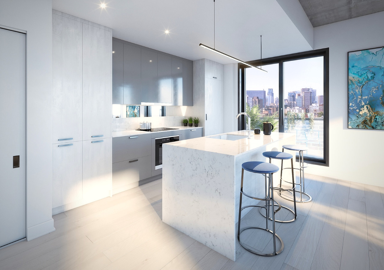 kitchen in a condo with a large window