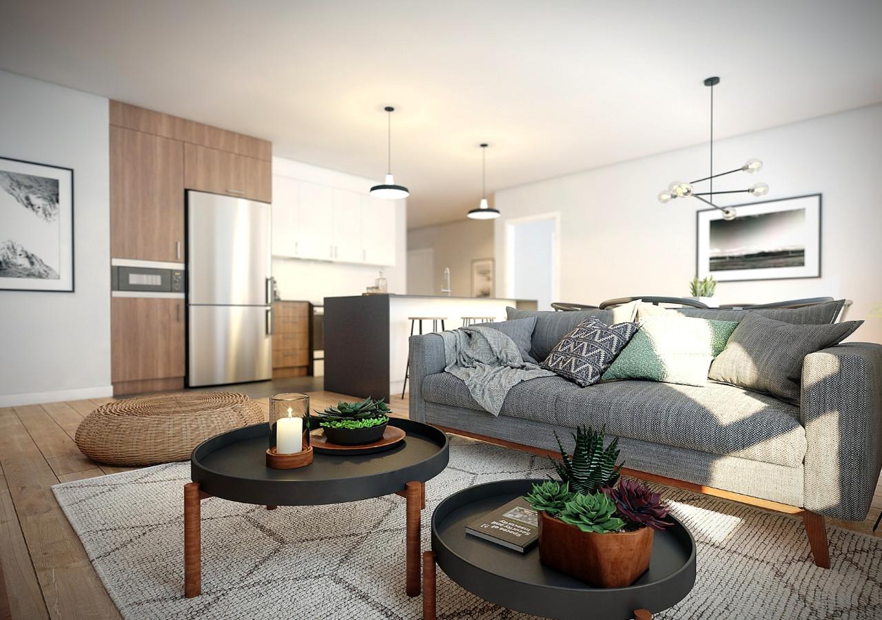 Salon lumineux avec cuisine en arrière plan