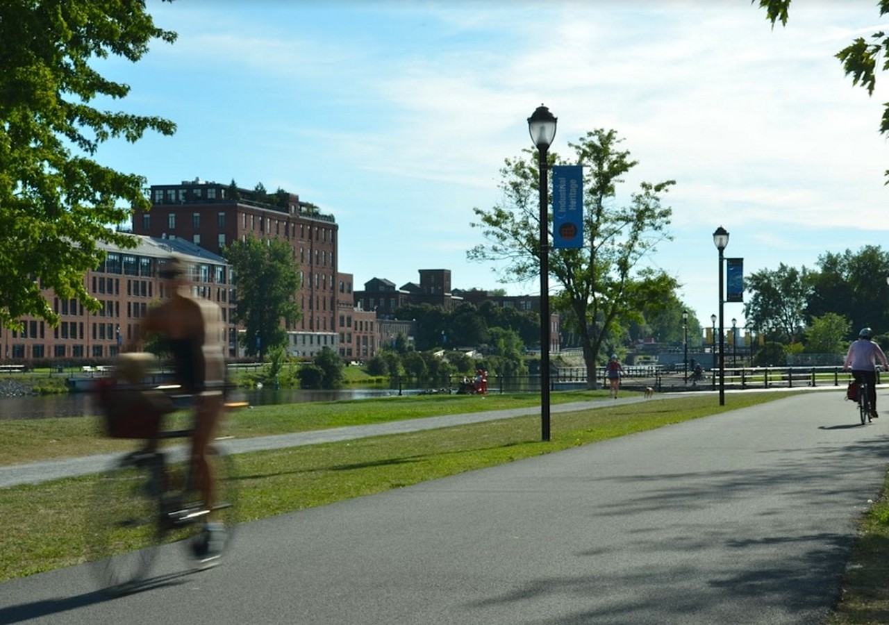 Woman riding a bike near the Lachine Canal