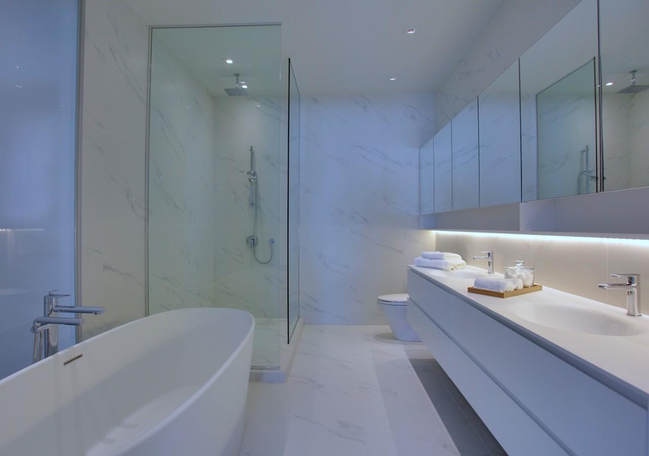 Bathroom with a shower and a bath