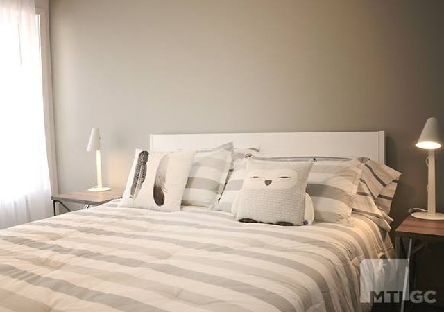 Chambre des maîtres avec lit de lin.