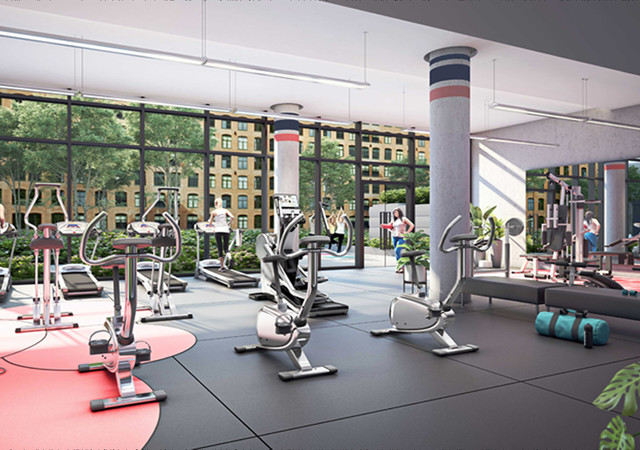 Gym with large windows and a view overlooking the park