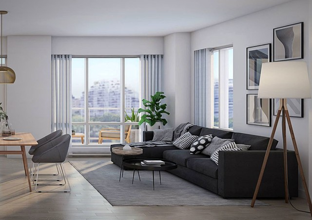 Livingroom with larges windows and a view of the city
