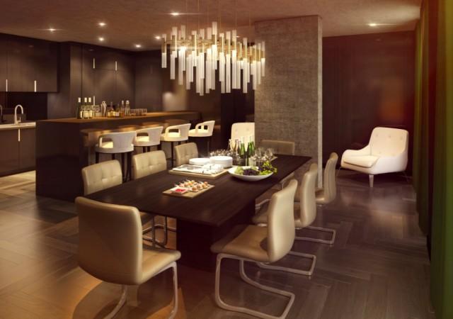 Salle à manger et cuisine en arrière plan avec lustre