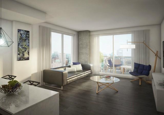 Salon lumineux avec plusieurs grandes fenêtres