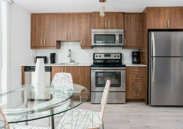 b et c kitchen with appliances and dining table
