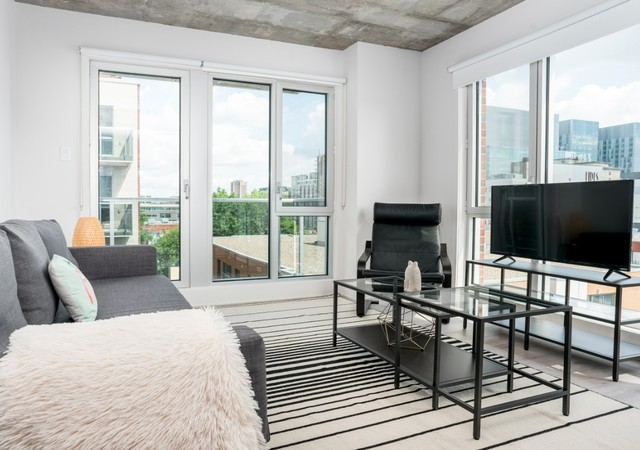 b et c Living room with a downtown view