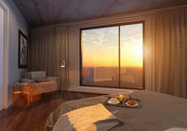 Chambre à coucher avec coucher de soleil