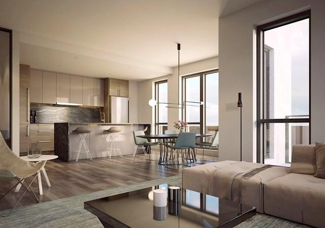 Salon beige avec cuisine en arrière plan