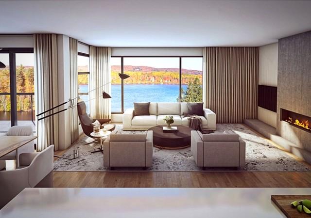 Grand salon avec foyer et vue sur la rivière