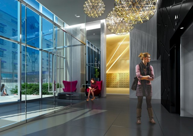 Halle d'entrée du bâtiment avec une femme qui attend l'ascenseur