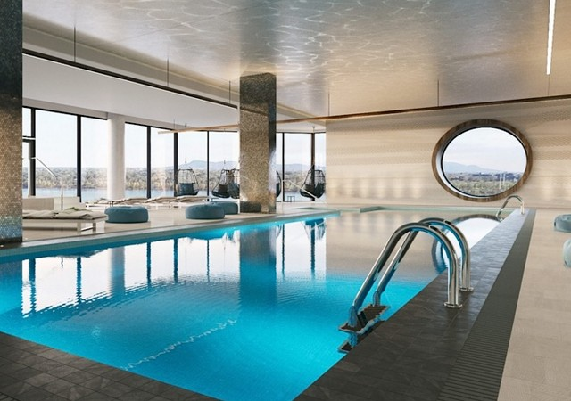 Indoor pool with view on the River