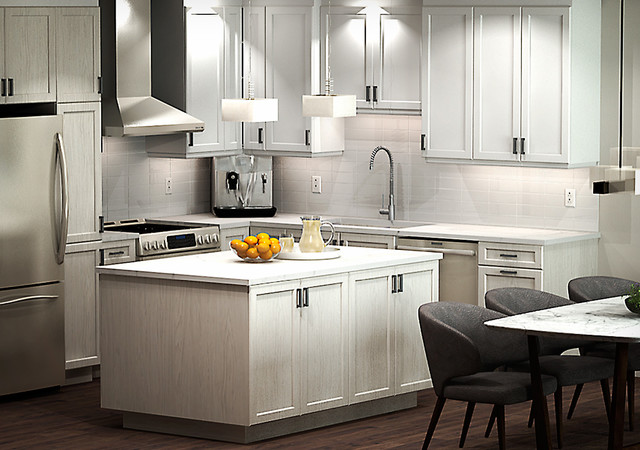 Large white kitchen with oranges on the countertop