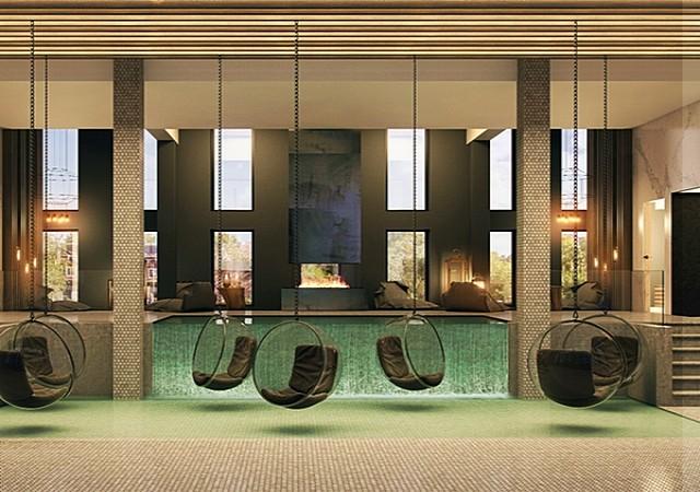 Lounge commun confortable avec chaises et foyer