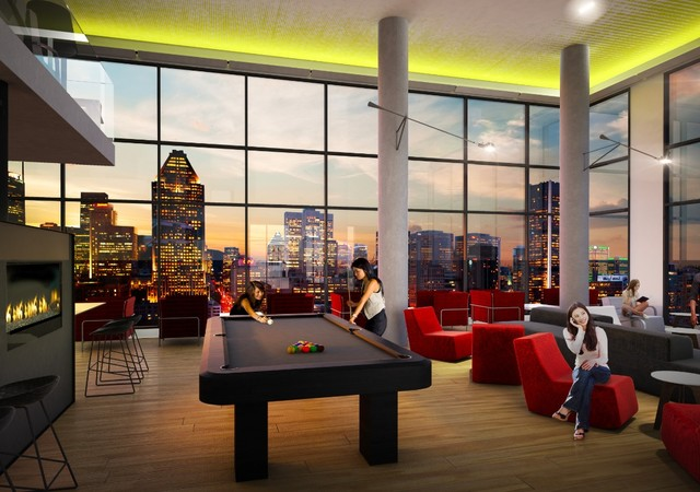 Public living room with a fire place and a view of downtown Montreal