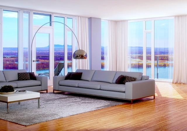 Grand salon avec vue sur le fleuve