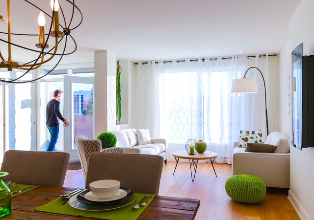 Living room with a man opening the balcony door