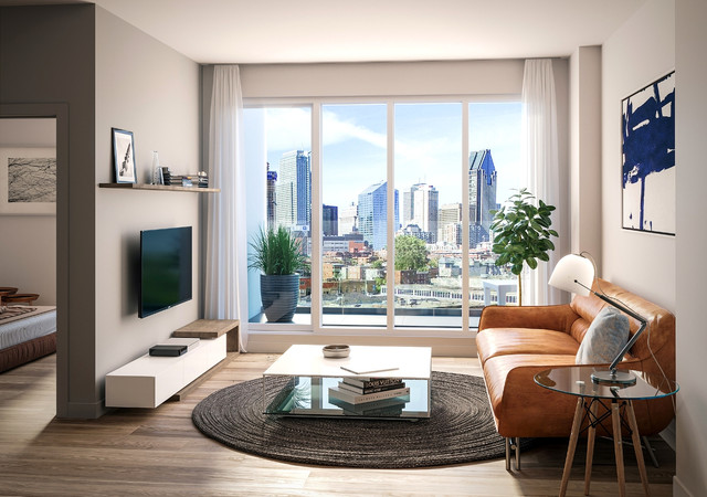 Will + Rich a living room with view of the city