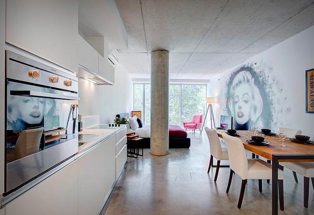 salle à manger et cuisine dans l'unité à aire ouverte